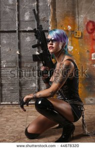 stock-photo-punk-rock-girl-with-an-assault-rifle-44678320